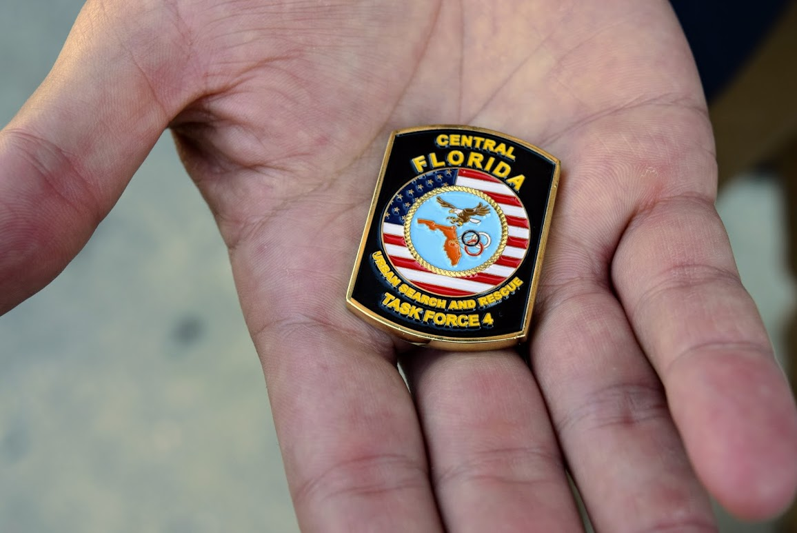 JImmy Patronis's hand is shown holding a challenge coin in his palm that reads
