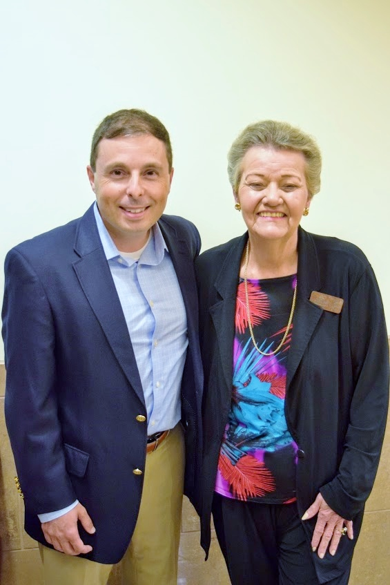 Clermont Mayor Gail Ash posing for a photograph with Mike Carroll, co-founder of Olympus