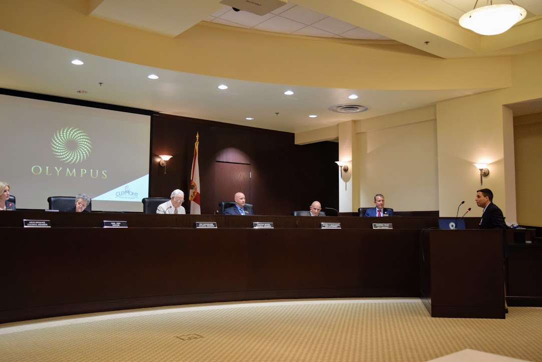 Council listening to presentation during city council meeting
