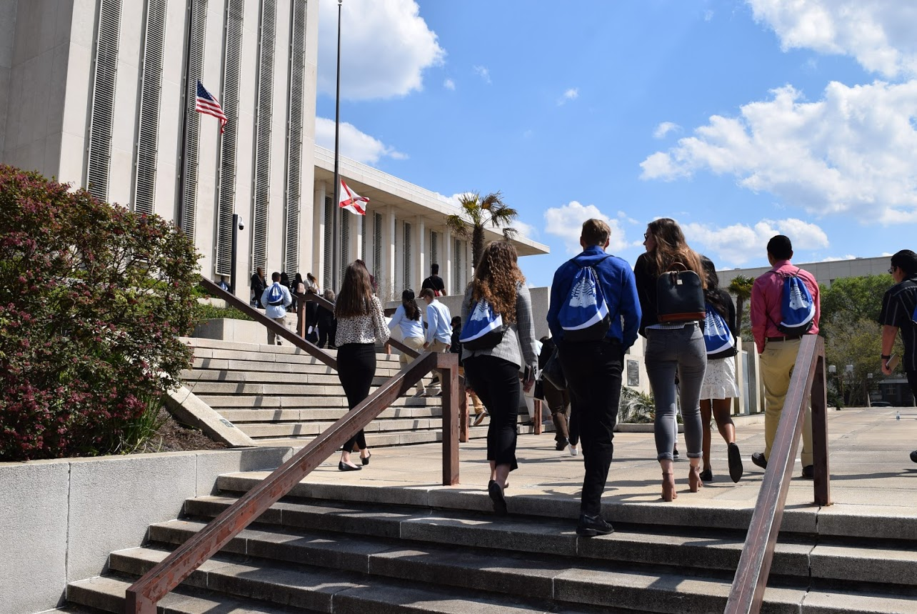 Youth Council members walking up the steps in Tallahassee