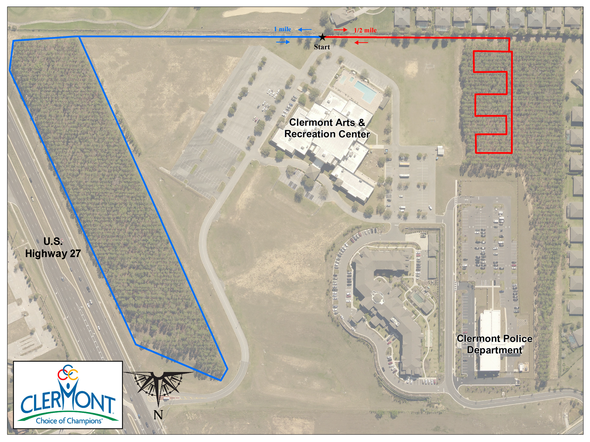 map of walking trails at Clermont Arts and Recreation Center, blue line on left with loop shows one mile trail, red winding line shows half mile trail on right