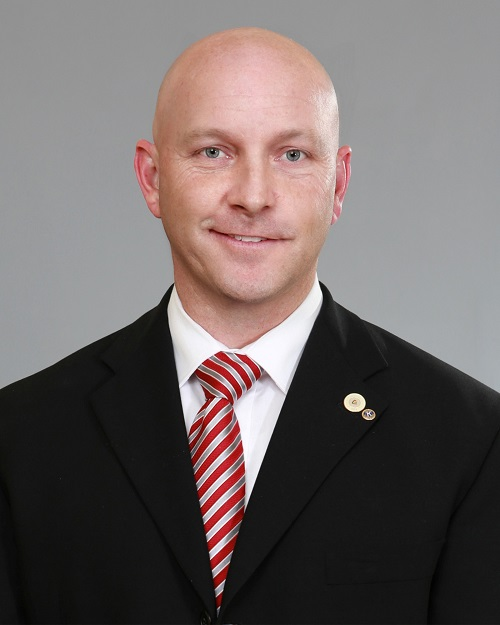 council member head shot in formal suit jacket and tie